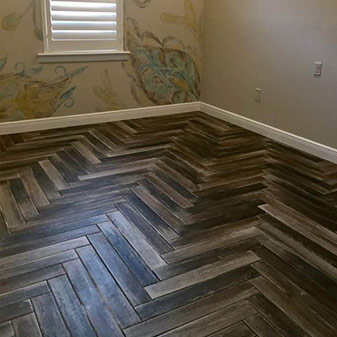 Porcelain plank tile install by Naples Abbey Carpet & Floor.